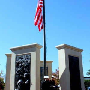 Low relief bronze sculpture monument of Veteran's by Charles Pate Jr in Greenville SC