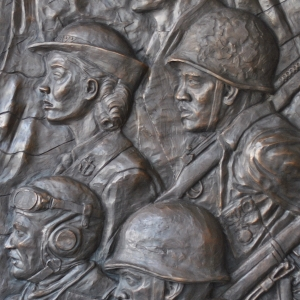 Low relief bronze sculpture monument of Veteran's in WWII by Charles Pate Jr in Greenville SC